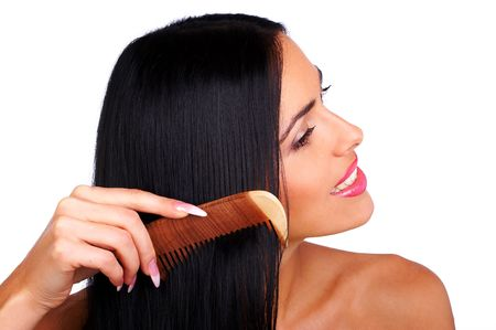 sensational: Young woman combing her hair. Isolated over white backround