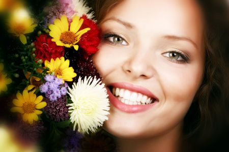 Happy young smiling woman with bunch of flowers Stock Photo - 656277