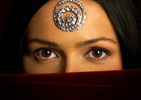 Mysterious eastern pretty woman with beautiful eyes. Stock Photo - 656272