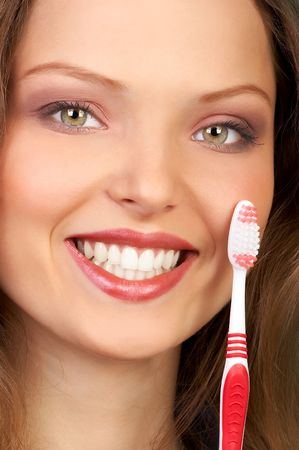Young beautiful smiling woman with great white teeth holding a toothbrush photo