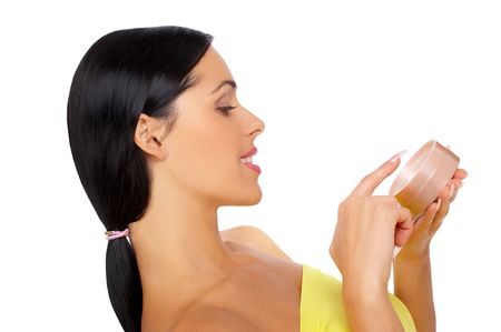 sensational: Young pretty woman applying make up. Isolated over white background 스톡 사진