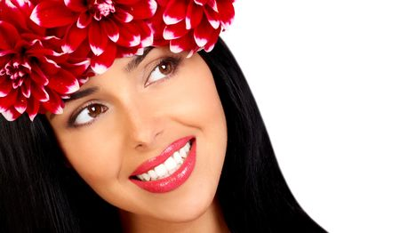Beautiful young woman with diadem of red flowers.