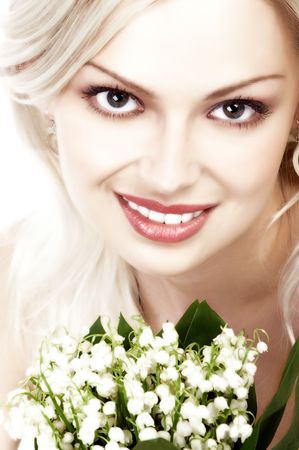 Pretty woman with lily of the valley Stock Photo - 685224