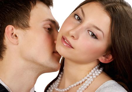 Happy young couple in love kissing. Isolated over white background Stock Photo - 700451