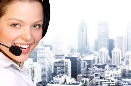 girls talk by phone: Business woman with headset. Over business center background