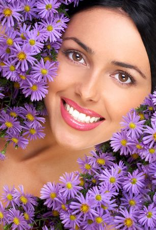 fem: Happy young smiling woman with bunches of flowers Stock Photo