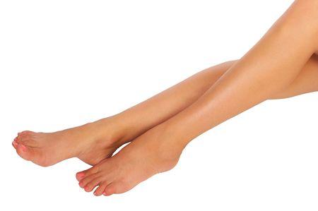 fem: Beautiful woman legs. Isolated over white background Stock Photo