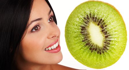 Laughing woman with kiwi. Isolated over white