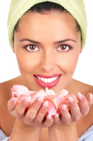 Young pretty woman holding and smelling pink rose petals Stock Photo