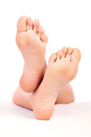 fem: Beautiful woman feet. Isolated over white background