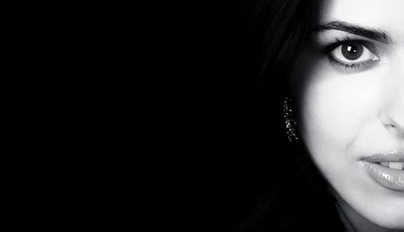 Mysterious pretty woman with beautiful eyes over black background Stock Photo - 801012
