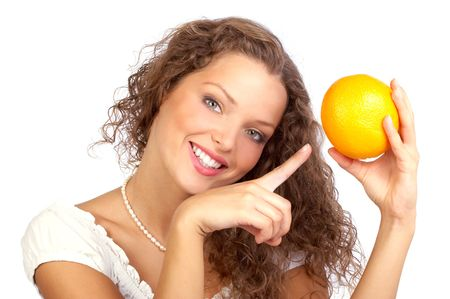 to tempt: Beautiful young woman holding an orange.  Close up  Stock Photo