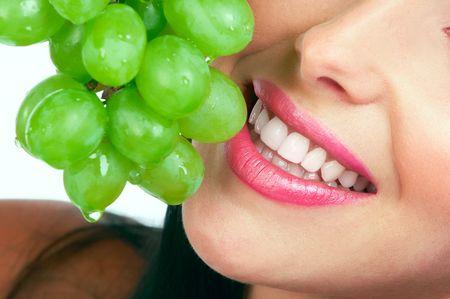 virgin girl: Beautiful young woman with green grape