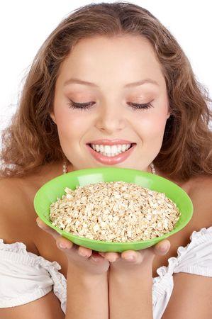nourish: Pretty  woman holding a plate with muesli  Stock Photo