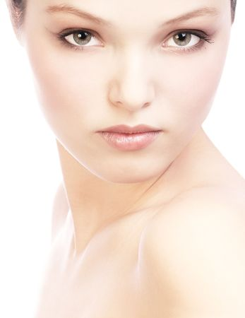 Beautiful young woman face . Over white background  photo