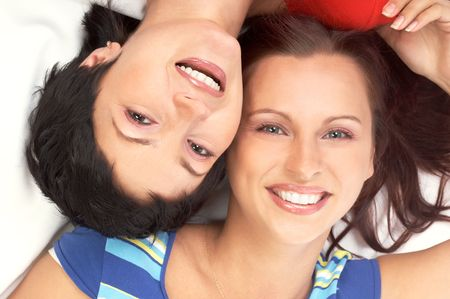 Happy young women friends laughing.  Over white background Stock Photo - 943379