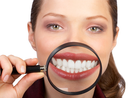 Young woman showing her healthy teeth. Isolated over white background photo