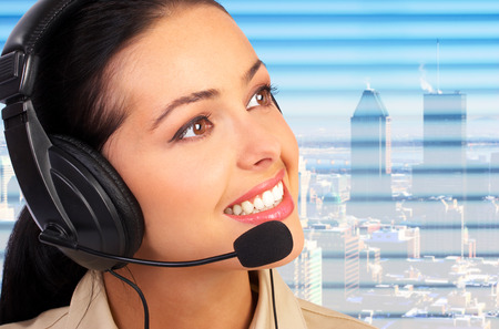 Business woman with a  headset. Operator of a call center photo