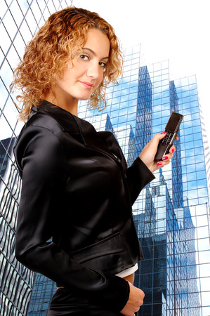 attractive young woman calling by cellular phone. Stock Photo - 1622697