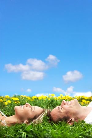 Young love couple sleeping on green grass Stock Photo - 3084017