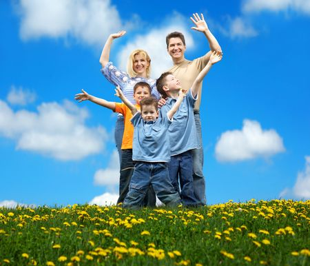 Family under blue sky. Father, mother and sons in the park Stock Photo - 3084019
