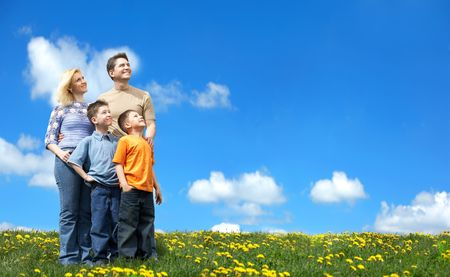Family undr blue sky. Father, mother and sons in the park Stock Photo - 3084020