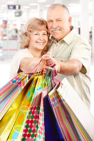 Happy shopping elderly people in the mall photo