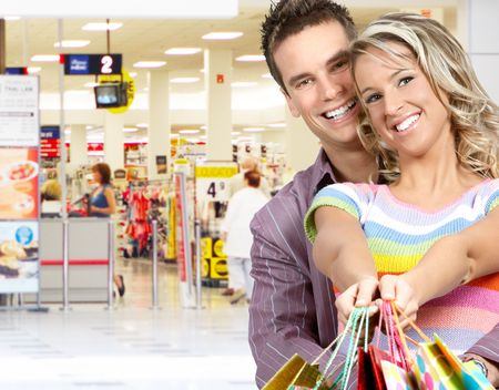 Shopping  smile couple at the mall  photo