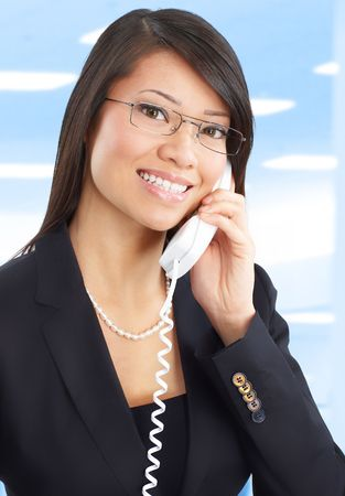 Young smiling business woman calling by  phone.  photo