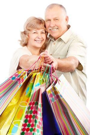 Happy shopping elderly people. Isolated over white background  photo