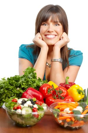 Young smiling woman  with fruits and vegetables. Over white background  photo