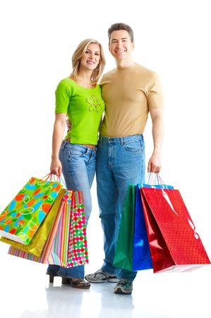 Shopping  couple  smiling. Isolated over white background   photo