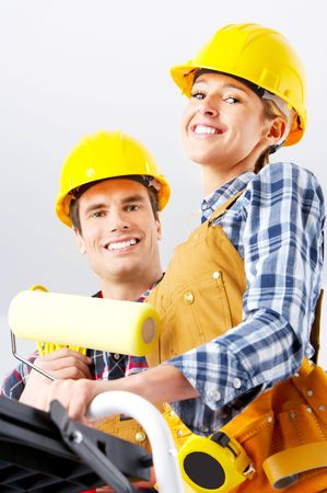 Young smiling builder people in yellow uniform  photo
