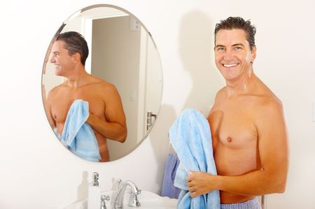 Smiling handsome man in the bathroom