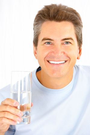 man drinking water: Handsome smiling man drinking water  Stock Photo