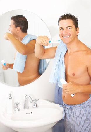 Smiling handsome man in the bathroom Stock Photo - 5487302
