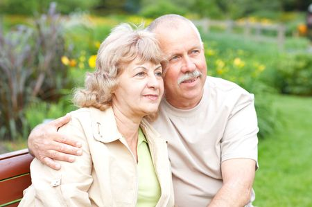 Smiling happy  elderly couple in summer park  photo