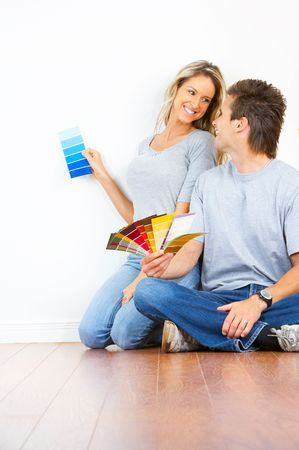 smiling couple choosing color for the  inter wall of home.  Stock Photo - 5525668