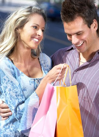 Shopping  smile couple on the street  photo
