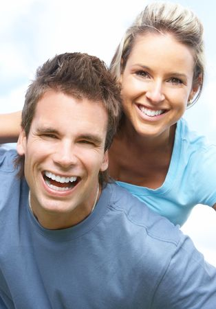 Happy smiling couple having fun outdoor Stock Photo - 5525746