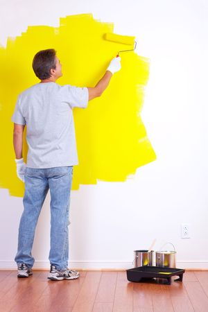 smiling handsome man near the painted  inter wall of home.  Stock Photo - 5525809