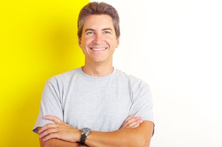 smiling handsome man near the painted  inter wall of home.  Stock Photo - 5525807
