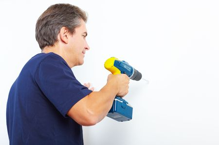 Handsome man with cordless hand drill. Renovation