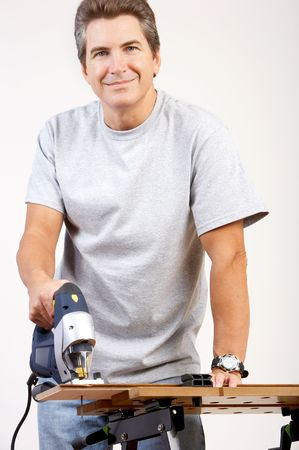 Handsome smiling man working at home. Renovation   photo