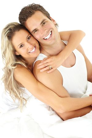 Young happy couple in a bed  photo