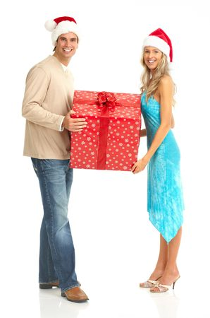 happy christmas: Young happy couple with a Christmas gift. Isolated over white background  Stock Photo