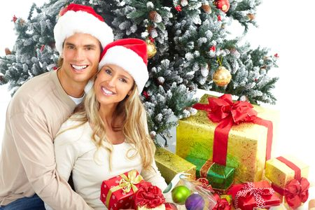 Young happy couple near  a Christmas tree. Isolated over white background Stock Photo - 5594039