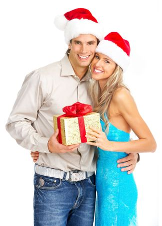 Young happy couple with a Christmas gift. Isolated over white background  photo