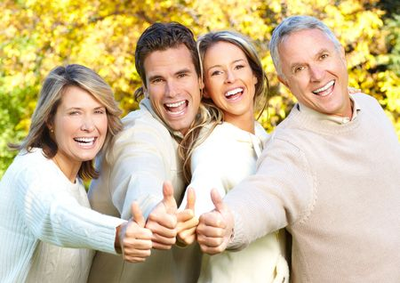 Happy family in park. Father, mother, son and daughter Stock Photo - 5614784