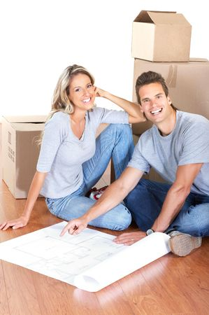 young couple sitting on the floor of a new house  photo